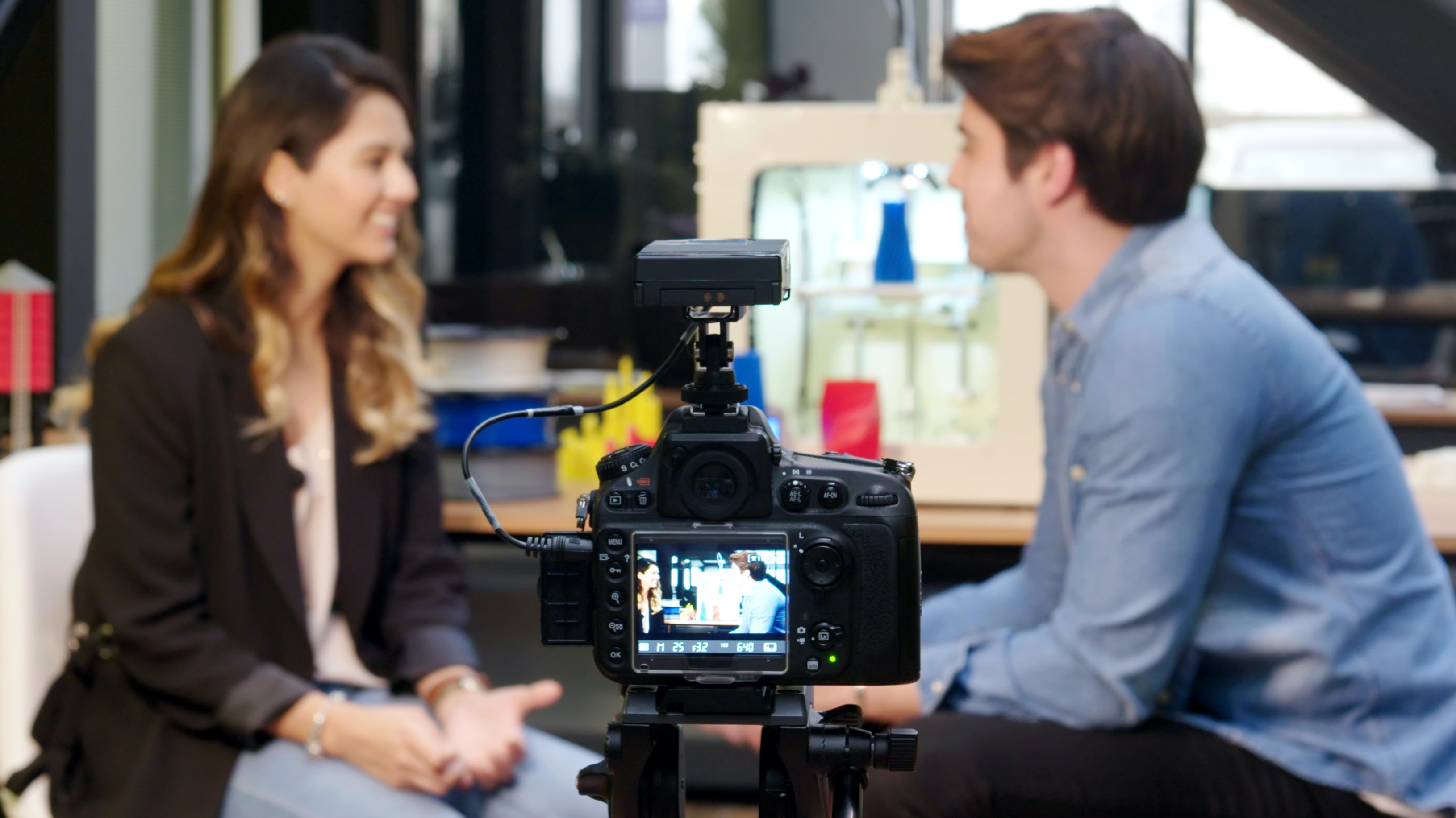 Man and woman being filmed in office environment